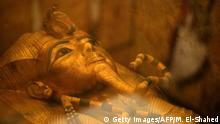 This picture taken on January 31, 2019 shows the head of the golden sarcophagus of the 18th dynasty Pharaoh Tutankhamun (13321323 BC), displayed in his burial chamber in his underground tomb (KV62) in the Valley of the Kings on the west bank of the Nile river opposite the southern Egyptian city of Luxor (650 kilometres south of the capital Cairo). - The famous tomb underwent a nine-year conservation by a team of international specialists. (Photo by MOHAMED EL-SHAHED / AFP) (Photo credit should read MOHAMED EL-SHAHED/AFP/Getty Images)