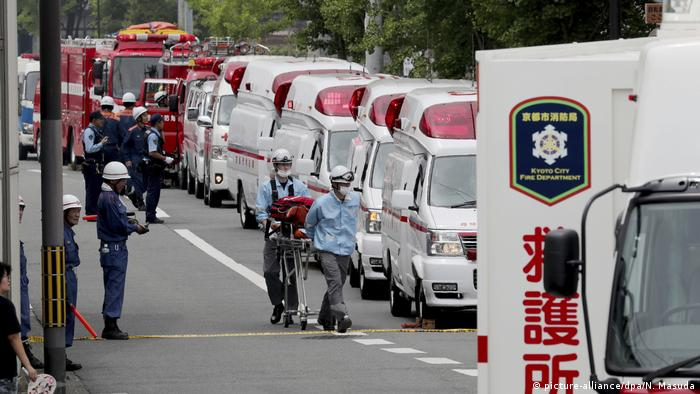 Emergency service vehicles outside the Kyoto animation studio