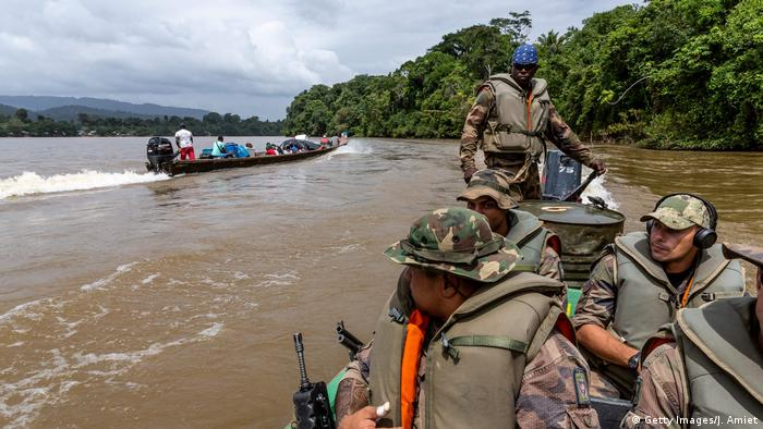 Soldiers in a boat in French Guiana