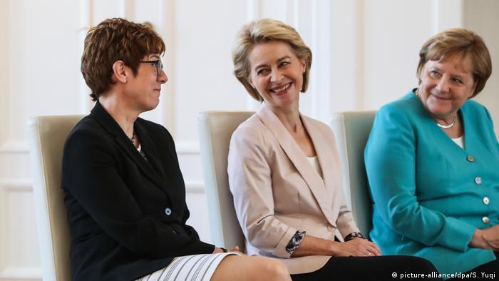 Annegret Kramp-Karrenbauer, Ursula von der Leyen and Angela Merkel sitting in Berlin
