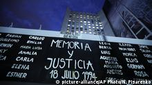 A sign reading in Spanish Memory and Justice and the names of those who died during the bombing of the AMIA Jewish center that killed 85 people is displayed outside the site of the attack on the 25th anniversary of the bombing in Buenos Aires, Argentina, Thursday, July 18, 2019. (AP Photo/Natacha Pisarenko) |