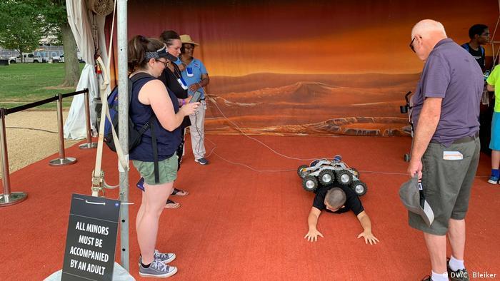 Mars rover replica rolling over a child at the Apollo 50 Festival in Washington
