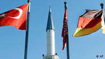 turkish and german flags and a minaret