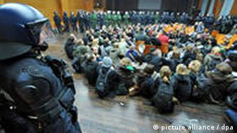 Students sit in at Frankfurt University watched closely by police