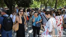 People evacuated from a building in Athens