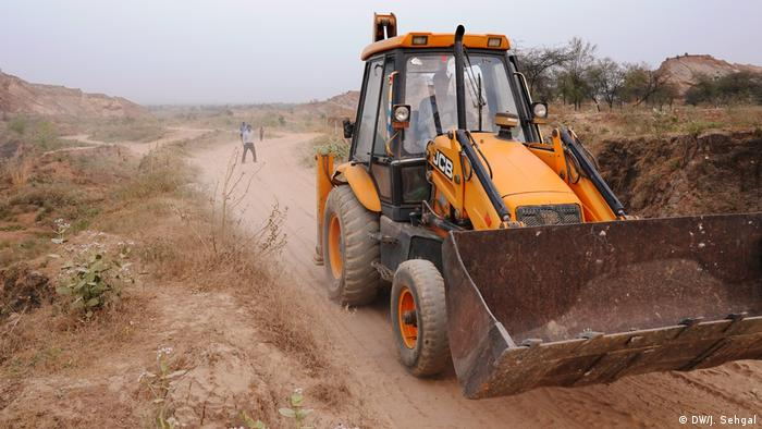 An excavator on a dirt road