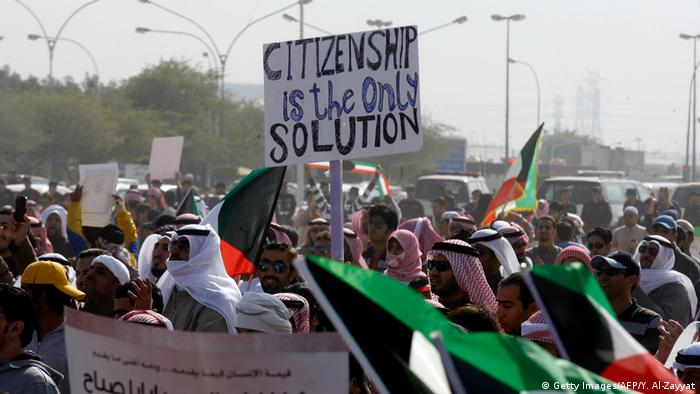 Protesters holding banner reading 'Citizenship is the only solution' at protest in 2011 (Getty Images/AFP/Y. Al-Zayyat)