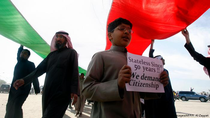 Bedoon protesters holding Kuwaiti flag