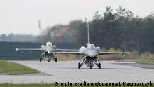 epa03936450 Polish Air Force F-16 fighters are seen on a runway during NATO's Steadfast Jazz 2013 excercises at the 31. Tactical Air Base in Poznan-Krzesiny, near Poznan, Poland, 05 November 2013. NATO's Steadfast Jazz 2013 excercises are taking place in Poland and Latvia from 02 to 09 November. EPA/JAKUB KACZMARCZYK POLAND OUT |