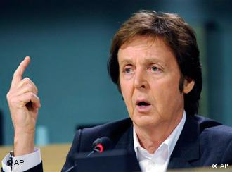 Musician and founder of Meat-Free Monday Sir Paul McCartney gestures while talking to the media during a press conference at the European Parliament in Brussels, Thursday Dec. 3, 2009. Paul McCartney spoke at the European Parliament's hearing on Global Warming and Food Policy in order to launch his key message Less Meat equals Less Heat, one week before the Copenhagen summit. (AP Photo/Thierry Charlier)
