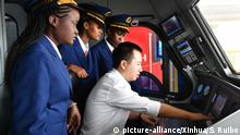 (190227) -- BEIJING, Feb. 27, 2019 (Xinhua) -- Train drivers Concilia, Wendy, Caroline (from L to R) follow the operating procedures with their Chinese instructor Zhang Cheng during training in Nairobi, Kenya, May 17, 2017, before the operation of Kenya's Mombasa-Nairobi Standard Gauge Railway (SGR). (Xinhua/Sun Ruibo)   Keine Weitergabe an Wiederverkäufer.