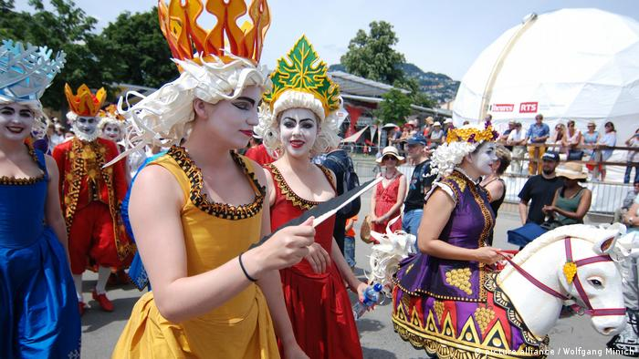 Revelers dressed in costumes join in celebrations for Fete des Vignerons