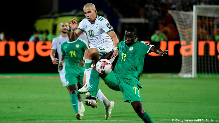 Senegal's midfielder Badou Ndiaye (R) vies for the ball with Algeria's midfielder Sofiane Feghouli during the 2019 Africa Cup of Nations (CAN) Final football match between Senegal and Algeria at the Cairo International Stadium in Cairo on July 19, 2019.