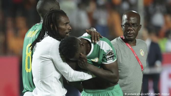 Senegal's head coach Aliou Cisse hugs Senegal's Ismaila Sarr after loosing the African Cup of Nations final soccer match between Algeria and Senegal in Cairo International stadium in Cairo, Egypt, Friday, July 19, 2019.