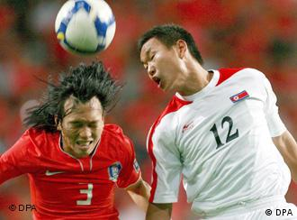 South Korean player Kim Chi-woo (L) fights for the ball with North Korean player Jong Tae-se (R) during their 2010 World Cup Qualifier South Korea vs North Korea soccer match at Sangam World Cup Stadium in Seoul, South Korea, 22 June 2008.