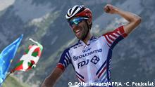Thibaut Pinot celebrates as he wins on the finish line of the fourteenth stage of the 106th edition of the Tour de France cycling race between Tarbes and Tourmalet Bareges, in Tourmalet Bareges on July 20, 2019. (Getty Images/AFP/A.-C. Poujoulat)
