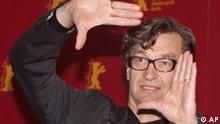 German director Wim Wenders gestures during a photo call prior to a news conference about his new film Viel passiert - Der BAP Film (Ode to Cologne) on the German rock band BAP, which is running out of competition at the 52nd Berlinale International Film Festival, in Berlin on Wednesday, Feb. 13, 2002. (AP Photo/Jan Bauer) (Photo für Kalenderblatt)