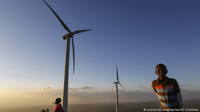 Children playing near Kenyan wind turbines