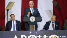 Vice President Mike Pence, center, makes remarks as NASA administrator Jim Bridenstine, back left, and Apollo 11 astronaut Buzz Aldrin listen during a visit to the Kennedy Space Center in recognition of the Apollo 11 anniversary, Saturday, July 20, 2019, in Cape Canaveral, Fla. (AP Photo/John Raoux)  