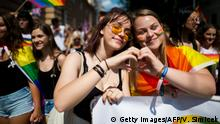 July 14, 2018*** A couple shapes a heart with their hands during the annual Rainbow Pride Parade of the Lesbian, Gay, Bisexual and Transgender (LGBT) community on July 14, 2018 in Bratislava, Slovakia. (Photo by VLADIMIR SIMICEK / AFP) (Photo credit should read VLADIMIR SIMICEK/AFP/Getty Images)