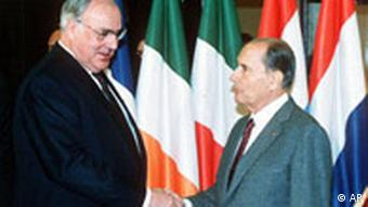 File - (AP) West german Chencellor Helmut Kohl (left) is greated by French President Francois Mitterand as he arrives at Strasbourg's Palais des Congres for the opening session of the Euroean Community Summit, Friday (AP-Photo/Fritz Reiss) 1989