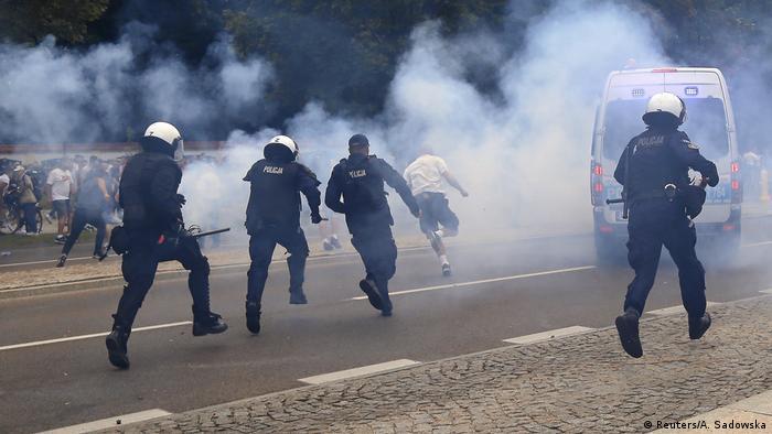 Police pursuing far-right protester amid smoke
