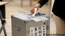 20.7.2019*** A voter casts a ballot at a voting station during Japan's upper house election in Tokyo, Japan July 21, 2019. REUTERS/Issei Kato