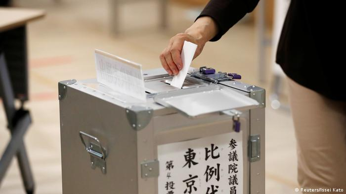 A voters casts a ballot in Japan's upper house election