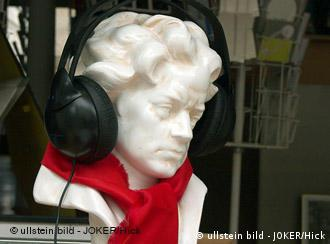 Beethoven bust with earphones and red scarf