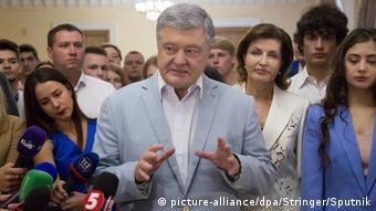 Petro Poroshenko gestures during a press briefing