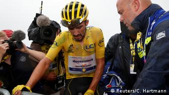 Julian Alaphilippe looked tired at the end of stage 15, but still has the yellow jersey