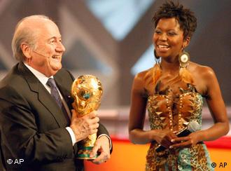 FIFA President Sepp Blatter holds the World Cup at the draw in Cape Town