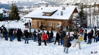 Journalists wait outside Polanski's chalet in Gstaad, Switzerland