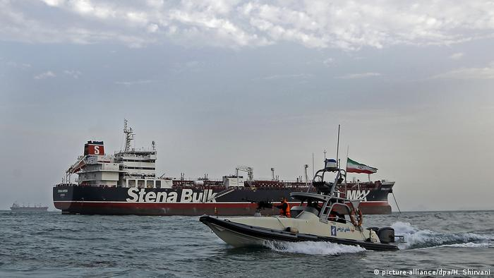 The Stena Impero oil tanker next to a boat from the Iranian Revolutionary Guards