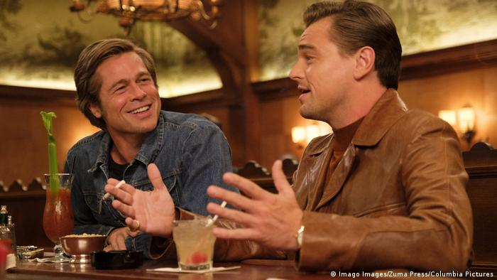Brad Pitt and Leonardo DiCaprio seated at a bar in a film still (Imago Images/Zuma Press/Columbia Pictures)