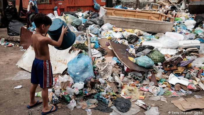 Children in Brazil play with heaps of waste