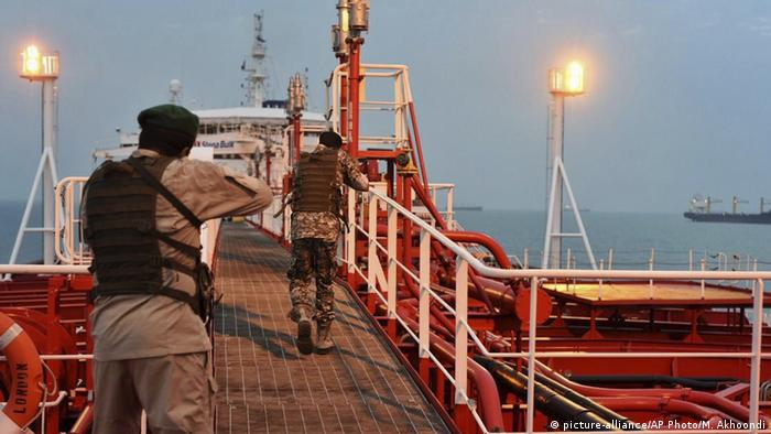 Two Iranian soldiers inspect the British-flagged oil tanker Stena Impero