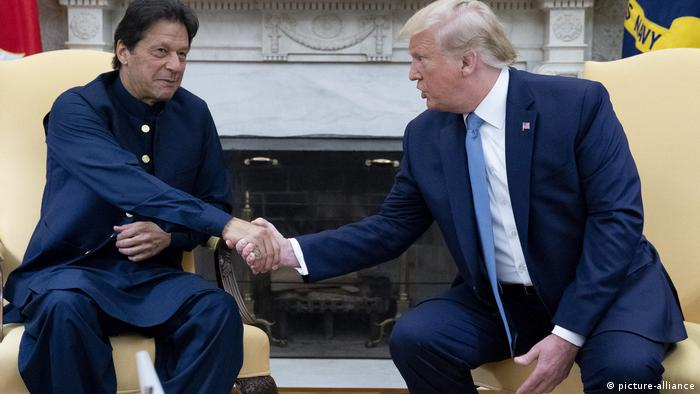 US President Donald Trump shakes hands with Pakistani PM Imran Khan in the Oval Office