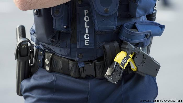 A police officer wearing a belt with a Taser
