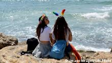 A lesbian couple sits by the Mediterranean Sea after the annual Gay Pride Parade in Tel Aviv, Israel, June 13, 2014. Tens of thousands of Israelis and foreign gay and lesbians joined the pride parade, which is the largest of it s kind in the Middle East. Tel Aviv has emerged as one of the world s most gay friendly travel destinations, in contrast to the rest of the region where being gay or lesbian is taboo. PUBLICATIONxINxGERxSUIxAUTxHUNxONLY JER2014061323 a Lesbian COUPLE sits by The Mediterranean Sea After The Annual Gay Pride Parade in Tel Aviv Israel June 13 2014 Tens of thousands of Israelis and Foreign Gay and lesbians Joined The Pride Parade Which IS The Largest of IT S Child in The Middle East Tel Aviv has emerged As One of The World S Most Gay Friendly Travel Destinations in contrast to The Rest of The Region Where Being Gay or Lesbian IS Taboo PUBLICATIONxINxGERxSUIxAUTxHUNxONLY JER2014061323