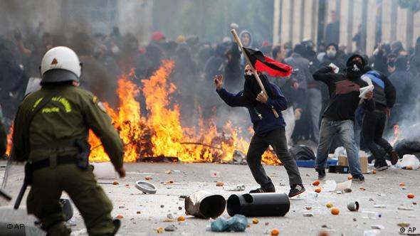 Anarchists throw stones at riot police during clashes in Athens