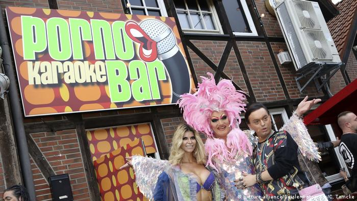 Olivia Jones poses in front of the Porno Karaoke Bar at its grand opening in Hamburg, Germany