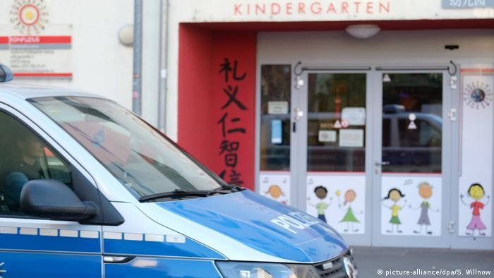 A police car parked in front a daycare center in Leipzig, Germany