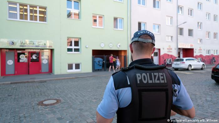 A police officer stands outside of a day care in Leipzig, Germany
