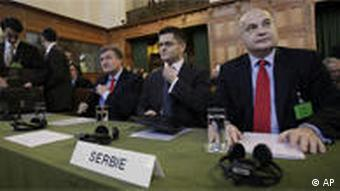 Head of the Serbian delegation and Serbia's ambassador to France, Dusan Batakovic, Vuk Jeremic, Serbian foreign minister, and Cedomir Radojkovic, Serbia's ambassador to the Netherlands,attend the opening of hearings at the International Court of Justice