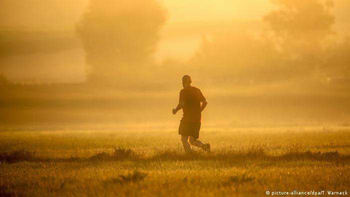 Heat wave, man jogging in Unlingen in southwestern Germany.