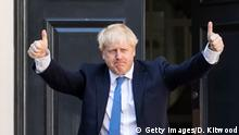 Newly elected Conservative party leader Boris Johnson poses outside the Conservative Leadership Headquarters on July 23