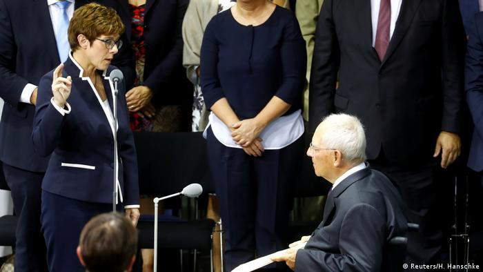 Germany's new Defence Minister Annegret Kramp-Karrenbauer is sworn-in by Parliament President Wolfgang Schaeuble