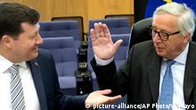 European Commission President Jean-Claude Juncker, right, is greeted by European Commission Secretary General Martin Selmayr during a meeting of the College of Commissioners at EU headquarters in Brussels, Wednesday, May 15, 2019. (AP Photo/Virginia Mayo)