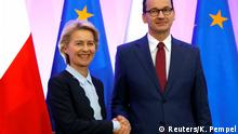 Incoming head of the European Commission Ursula von der Leyen shakes hands with Polish Prime Minister Mateusz Morawiecki at the Prime Minister Chancellery in Warsaw, Poland July 25, 2019. REUTERS/Kacper Pempel